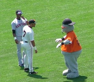 Giants and Mets player with the Giants mascot