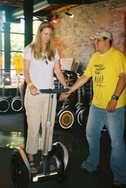 Cindie on a Segway with an instructor