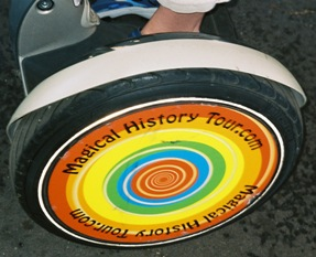 "Picture of the wheel of the Segway that shows ""Magical History Tour.com"""
