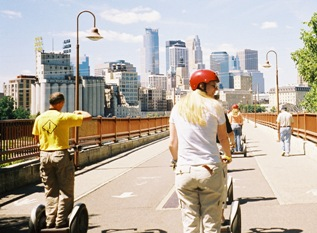 Segway riding over a bridge towards St. Paul, MN