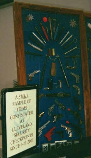 "Sign reads ""A small sample of items confiscated at Cleveland Security checkpoints since 9-11-2001"""